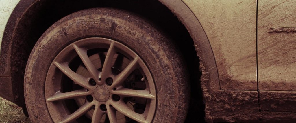 Car tire covered in mud